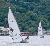 13-year old Junior sailor Carlos Leonel Sanchez of Utulei village leads into the first turn at the red buoy