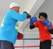 Trainer, Sala Senele Etuale hitting the pad with one of the local boxers