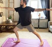 In this March 19, 2020, photo made available by Steve Latart, Latard does yoga exercises at his home in Rogers, Minn.