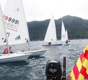 Laser sailors sitting at the ready waiting for the start flag to drop