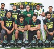 Pictured are some of the sons of Samoa who are currently on the roster, with MSSU running back coach, Keiki Misipeka (far right); academic support specialist, Rachel Jennings (far left) - both natives of American Samoa - and head coach Jeff Sims (middle row, center).