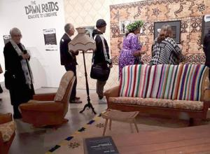 People file through the replica 1970s lounge at the exhibition