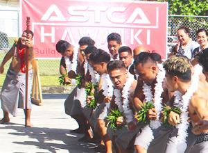"""With the """"ASTCA/Hawaiki"""" banner in the background, members of the Malaeloa Methodist Youth group perform"""