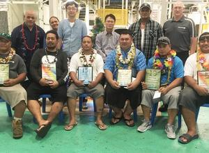 (Seated, l-r): Faamavaega Tanielu (10 years of service), Joseph Fale (5 years of service), Feai Taele (15 years of service), Desmond Petaia (10 years of service), Pio Vito Jr. (10 years of service) and Paul Tui (5 years of service).   (Standing l-r): Shift Supervisor Iakopo Ioane, Inventory Specialist Lusia Luaifoa, Chief Financial Officer Eogyoon Kim, Plant Manager Choelyour Lim, Shift Supervisor Iopu Mara, Electrical Supervisor Graeme Dunstan.