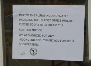 Photo of sign on door at USPS saying it would be closed TFN after plumbing problems discovered