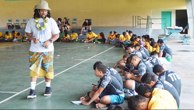 """A member of the team, headed by Jeremiah Masoli, speaking Monday morning to students, during the athletics clinic at Leone High School, which was the last public high school, visited by the team, during their one week on island. The San Francisco-based non-profit group CASEProject teamed up with Masoli, whose parents are from American Samoa, to set up literacy workshops — called """"Samoan Voice"""" — and football clinics throughout last week, including a """"football combine and skills clinic,"""" held last Saturday."""