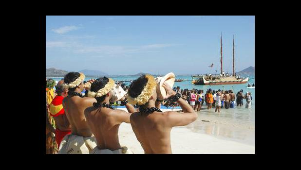 In this Sunday, May 1, 2005 file photo, traditional Halau dancers blow conch shells to welcome the Hokule'a voyaging canoe into Kailua Bay. The Polynesian double-hulled vessel was built to test anthropological migration theories. For years, Hawaii has ranked as one of the healthiest states, but a study released Friday, July 20, 2017 finds that original Hawaiians are in strikingly poor health. Surveys have long ignored native Hawaiians and other Pacific Islanders, or grouped them in with Asians. (AP Photo/Ro