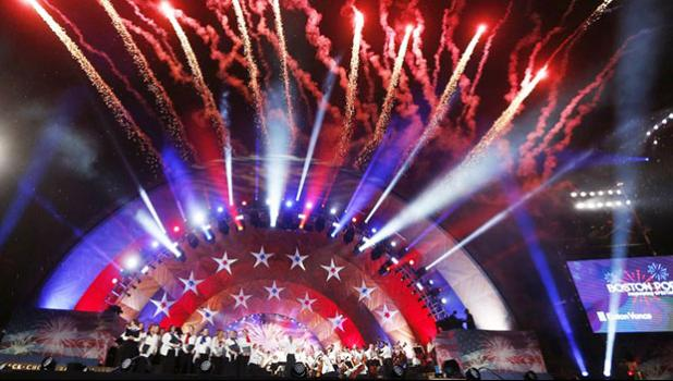 fireworks explode over the Hatch Shell during rehearsal for the Boston Pops Fireworks Spectacular in Boston