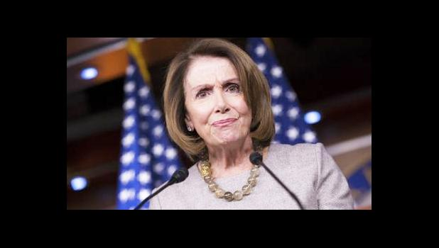 In this Feb. 16, 2017, file photo, House Minority Leader Nancy Pelosi of Calif. listens during a news conference on Capitol Hill in Washington. The AP reported on July 14, 2017, that a series of stories circulating online regarding a drug bust involving Pelosi's daughters is a hoax. (AP Photo/J. Scott Applewhite, File)