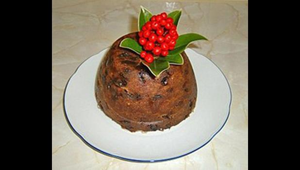 Christmas steamed pudding on a white plate