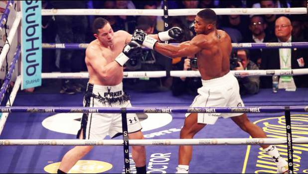 CARDIFF, WALES - MARCH 31: Anthony Joshua and Joseph Parker exchange punches during there WBA, IBF, WBO & IBO Heavyweight Championship title fight at Principality Stadium on March 31, 2018 [photo via NZ Herald]