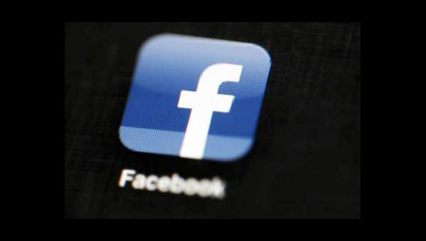 "In this May 16, 2012, file photo, the Facebook logo is displayed on an iPad in Philadelphia. Facebook is taking new measures to curb the spread of fake news on its huge and influential social network, focusing on the ""worst of the worst"" offenders and partnering with outside fact-checkers to sort honest news reports from made-up stories that play to people's passions and preconceived notions. (AP Photo/Matt Rourke, File)"