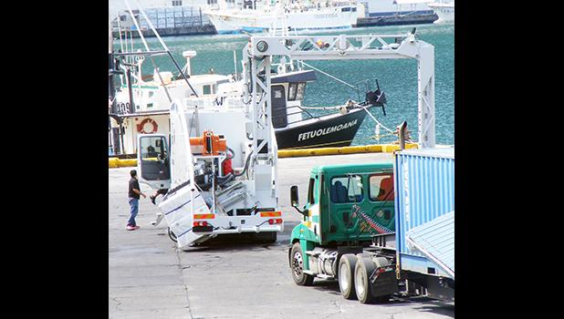 A truck with a container, prepares to go through the container scanner at the main dock around 2:30p.m Friday, Mar. 24, 2017 in Pago Pago, American Samoa. ASG Treasury says the container scanning fee of $200 per container of 20 foot and over, goes into effect Apr. 3. [photo: Fili Sagapolutele]