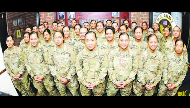 More than 30 members of an American Samoa family pose for pictures Nov. 8 at Thompson Hall. The Soldiers are advanced individual training students and most are enrolled in the Unit Supply Specialist Course taught by the Quartermaster School. In all,, there are 41 members of the same Samoan family training at Fort Lee. [Photo: Terrance Bell]