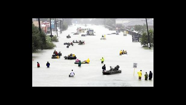 Rescue boats fill a flooded street as flood victims are evacuated as floodwaters from Tropical Storm Harvey rise Monday, Aug. 28, 2017, in Houston. (AP Photo/David J. Phillip)