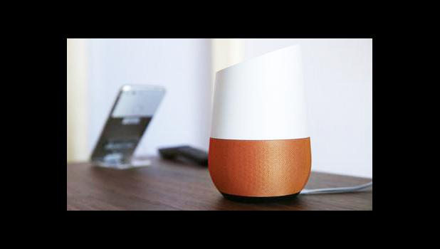 In this Tuesday, Oct. 4, 2016, file photo, Google Home, right, sits on display near a Pixel phone following a product event, in San Francisco. Voice assistants such as Google Home, Apple's Siri and Amazon Alexa have always been susceptible to accidental hijack. Burger King's manipulation of Google Home illustrates the vulnerabilities intrinsic to voice assistants that can be targeted by brands, or worse, hackers. But the stunt might help speed up the next developments for home voice assistants: individual v