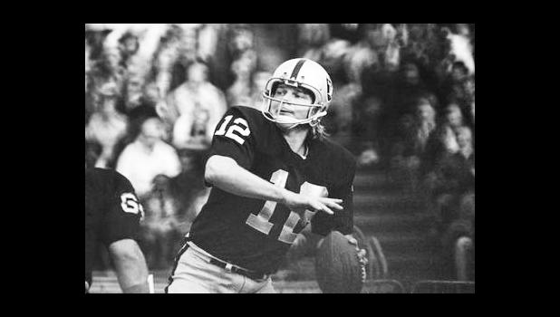 In this 1974 file photo, Oakland Raiders quarterback Ken Stabler looks to pass. According to a report released on Tuesday, July 25, 2017 by the Journal of the American Medical Association, research on 202 former football players found evidence of a brain disease linked to repeated head blows in nearly all of them, from athletes in the National Football League, college and even high school. Stabler is among the cases previously reported. (AP Photo/File)