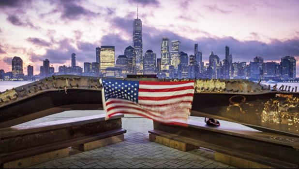 A U.S. flag hanging from a steel girder, damaged in the Sept. 11, 2001