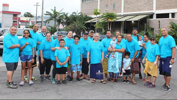 Pictured are church members in front of one of the few homeless shelters around Kakaako that houses women and children. The congregation recently paid a visit to the shelter, where members served food and drinks to the residents.  [courtesy photo]