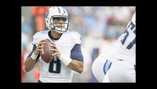 Marcus Mariota, a former Polynesian Player of the Year winner, will be one of the team captains for the Polynesian Bowl. Here the Tennessee Titans quarterback warms up before an NFL football game against the Minnesota Vikings Sunday, Sept. 11, 2016, in Nashville, Tenn. (AP Photo/Mark Zaleski)
