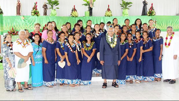 The American Samoa Women's U-16 team at the Leone Holy Cross Parish with Father Kelemete Pua'auli (far right), Fofo County Senator Faaivae Iuli Alex Godinet (2nd from left), and Sua County Senator Muagututia Tauoa (middle) on Sunday, July 30, 2017.  [FFAS MEDIA/Brian Vitiolio]