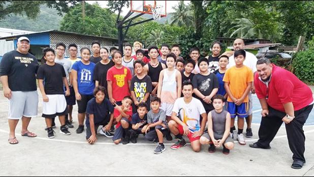 Aspiring basketball players participating in the ongoing ASBA summer clinic for the Central District, pictured with their coaches Diehl Langkilde and Milton Taufaasau. See story for full details.   [photo: Mark Espiritu]