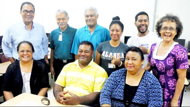 ASCC President Dr. Rosevonne Pato (seated, far left) joins the College's Business Department, some students and their parents for a photo following a presentation the department recently gave on the trip the class MKT 212 (Marketing & Management Practicum) made to Samoa earlier this month.  [Photo: J. Kneubuhl]