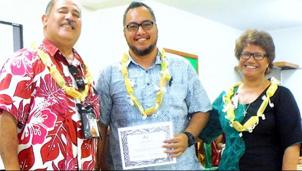Derek Helsham (center), chairperson of the ASCC Health & Human Services Department, receivimng an award from Vice President Dr. Lina Scanlan, and Agriculture, Community and Natural Resources/Land Grant Director Aufa'i Ropeti Apulu Areta during the College's Faculty Awards ceremony held at the beginning of the current semester.  [photo: J. Kneubuhl]