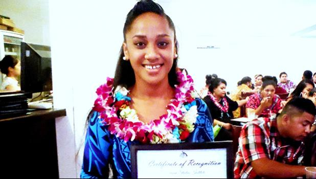Spring 2017 ASCC graduate Salome L. Saili displays her award from the Samoan Studies Department during the Graduate Banquet held last week. The event recognizes academic achievement and leadership in the diverse areas of study offered at ASCC.  [Photo: J. Kneubuhl]