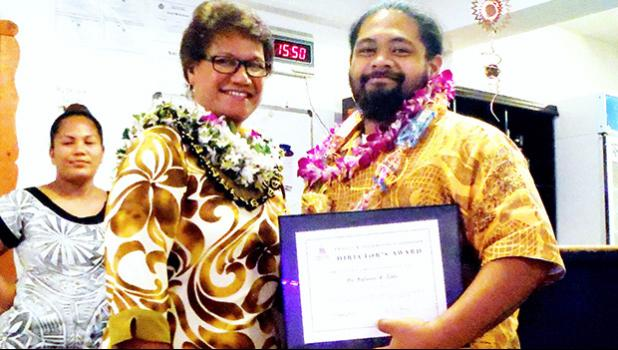 ASCC Vice President of Academic and Student Affairs Dr. Lina Galea'i-Scanlan (left) presents spring 2017 graduate Nafanua R. Tialu with the semester's Trades & Technology Award during the Graduate Banquet held last week. The event recognizes academic achievement and leadership in the diverse areas of study offered at ASCC.  [Photo: J. Kneubuhl]