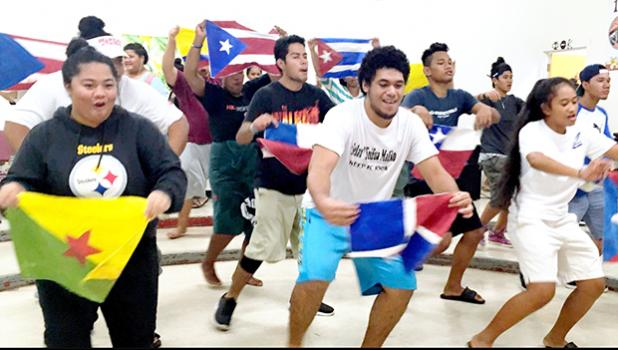 """Cast members of the ASCC 2017 theatrical production """"In The Heights"""" rehearse the Carnaval De Barrio scene. The play, set in the Dominican-American neighborhood of Washington Heights in New York City, will take place this coming Tuesday and Wednesday, May 2 and 3, in the Gov. H. Rex Lee Auditorium. Doors open at 6 p.m. and the show gets underway at 7:30. See story inside. [Photo: K. Tuiasosopo]"""