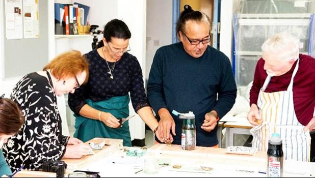 Artist Regina Meredith-Fitiao (2nd from left) of ASCC, with her husband Su'a Uilisone Fitiao of Pacific Horizons School, giving a siapo workshop at the University of Glasgow in Scotland. The workshop was for the benefit of museum professionals responsible for the care of historic siapo in their collections.  [courtesy photo]