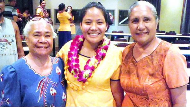 Monalisa Afoa (center) celebrates being inducted into the ASCC chapter of the Phi Theta Kappa International Honor Society last week. Afoa is pictured with ASCC faculty member Elisapeta Faalafi-Jones and Maria Perofeta.  [photo: J. Kneubuhl]