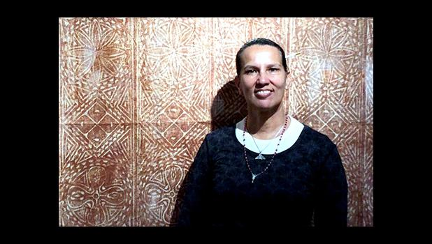 "ASCC visual artist Regina Meredith-Fitiao is seen with a large siapo she transported to San Francisco for inclusion in the Mission Cultural Center for Latino Arts exhibit ""Deep Blue Sea: String of Pearls,"" which also featured works by her husband Su'a Tupuola Uilisone Fitiao and a number of west coast artists.   [Courtesy Photo]"