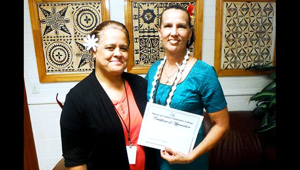 Local artist Regina Meredith-Fitiao of the ASCC Fine Arts Department  with ASCC President Dr. Rosevonne Makaiwi Pato. Meredith recently wrote an article on the dyes used for Samoan siapo, which has been published in Turkey Red Journal, an online resource for practitioners all over the world who work with making dyes and applying them.  (Photo: J. Kneubuhl)