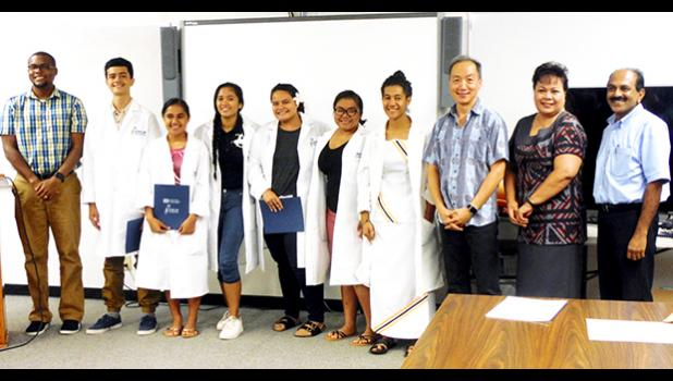 Local high school students and attendees of the 9th Annual STEP-UP High School Summer Research Symposium held at the Agriculture, Community and Natural Resources (ACNR) Division of the American Samoa Community College (ASCC) on July 22, 2017.  (L to R) Dr. Rob Rivers, Athanasius Talataina, Olyvia Ta′ase, Joelyn G. Rafil, Karallyn Fitisone, Finiana Finau, Tausala Judy Leota, Dr. George Hui, Netini Sene and Dr. Joserose Jyothibhavan.  [Photo: ASCC-ACNR]