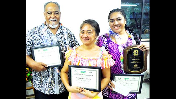 The ASCC Samoan Studies Institute held a ceremony in late November to recognize this year's winners for its writing competition in the Samoan language. (l-r) Moe Iefata, third place winner; Jaradine Ah Sam, second place winner; and 2017 first place winner Oneata Rosie Soi. [photo: J. Kneubuhl]
