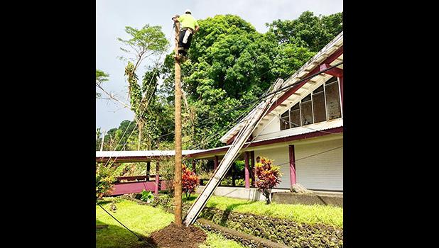 ASPA replaces a power pole at ASCC this past Saturday. [courtesy photo]