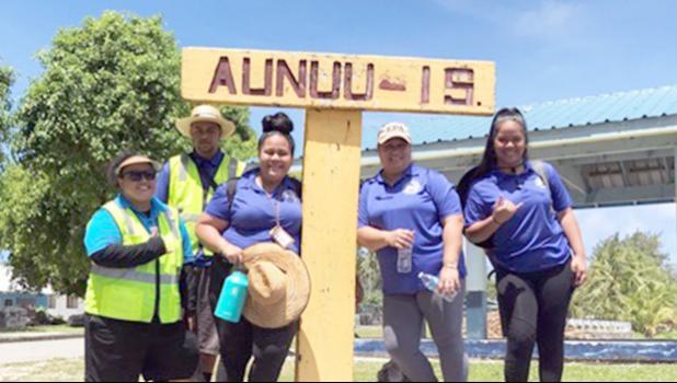 Three ASPA workers on a return boat ride last Friday from Aunu'u to Auasi.  [photo: Leua Aiono Frost]