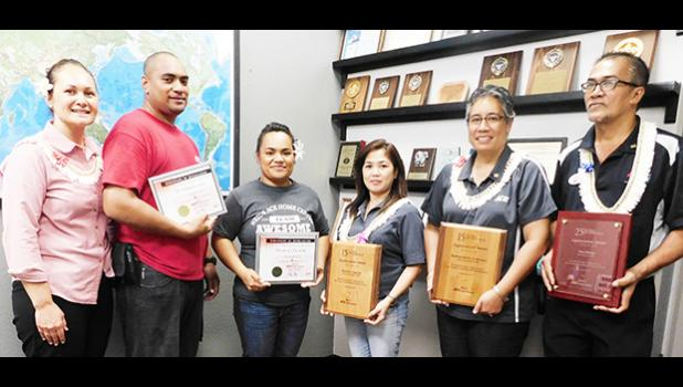 Neil's ACE Home Center held a small ceremony yesterday morning to recognize years of service for team members from 5- 25 years.  In this photo are CEO Ngaire Ho Ching (far left) and some of the recipients, who received service awards. Recipients recognized were Frank Ho Ching, Fernando Seti, Pisinisi Fa'alili, Joyce Ta'ala, Linda Brown, Eneliko Auseuga, Ugapaepae Koloi-Ampong, Marichu Cayanan, Nadine Solofa-Taufa'asau and Teni Ma'ae.  [Photo: EM]