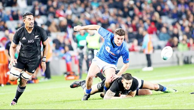 American Samoa's own Jerome Kaino, Sonny Bill Williams are unable to secure the ball due to ferocious Manu Samoa aggressive defense.  The New Zealand All Blacks defeated Manu Samoa 15s 78-0 at Eden Park, Auckland, New Zealand.   [Photo: Barry Markowitz]