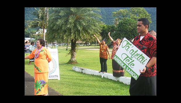 Congresswoman Aumua Amata (left) and her American Samoa staff this morning along the main highway in Utulei waving to motorist and thanking residents for re-electing her to a second term in office. [photo: Fili Sagapolutele]