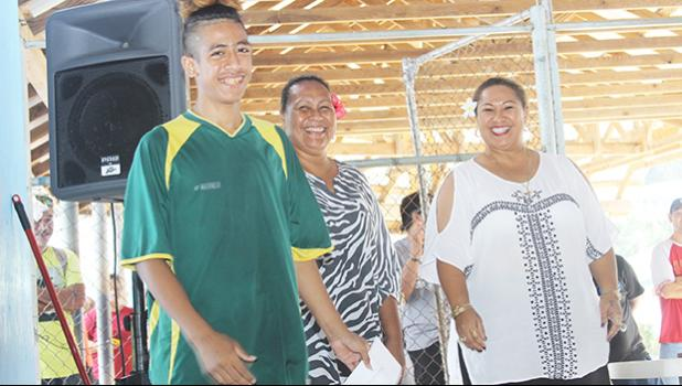 Austin Kaleopa, left, of Utulei Youth receives his 2017 FFAS Futsal Tournament's championship game MVP award from FFAS executive member Amio Mavaega-Luvu (middle) and FFAS Vice-President and FIFA Council member Sandra Fruean (right), on Monday, May 29 at the Samoana High School gymnasium in Utulei.