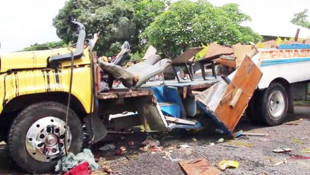 Footage of the incident's aftermath shows the bus crashed on the roadside without a roof and sides, and its seats badly damaged. [photo: Samoa Observer via MSN.com]