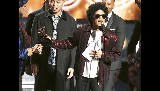 "ts the award for song of the year for ""That's What I Like"" at the 60th annual Grammy Awards at Madison Square Garden on Sunday, Jan. 28, 2018, in New York. (Photo by Matt Sayles/Invision/AP)"