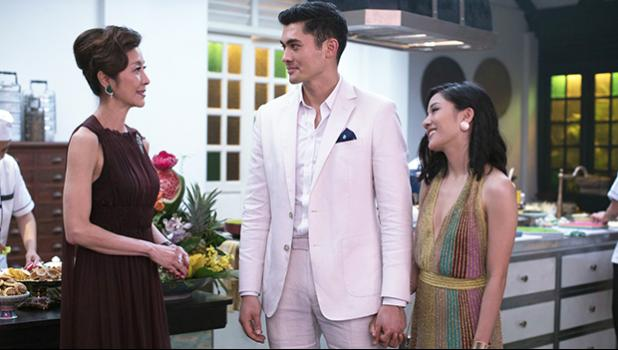 "This image released by Warner Bros. Pictures shows, from left, Michelle Yeoh, Henry Golding and Constance Wu in a scene from ""Crazy Rich Asians,"" in theaters on August 17. (Sanja Bucko/Warner Bros. Pictures via AP)"