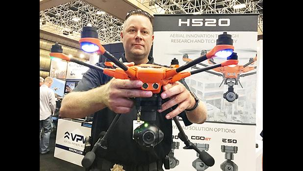 Nevada Hawaii Patrol's Sgt Wayne Prosser, shares the Yuneec H520 drone, which will aid their department in traffic accident investigation.    [Photo by Barry Markowitz]