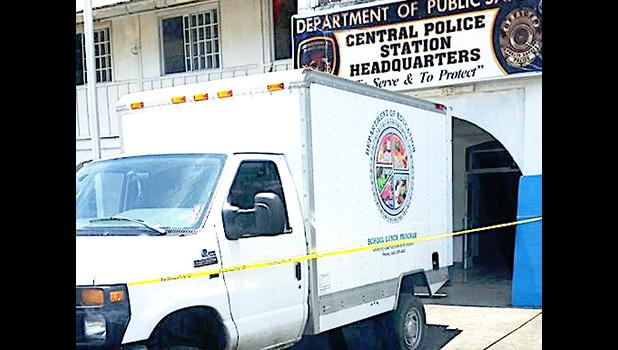 The DPS Main Central Station in Fagatogo was sealed off with yellow tape and guarded by armed cops yesterday morning, after a fire broke out on the second floor of the building, in the area where the CID unit is housed. Samoa News was unable to confirm why the DOE school lunch truck (pictured) was at the site. [photo: BC]