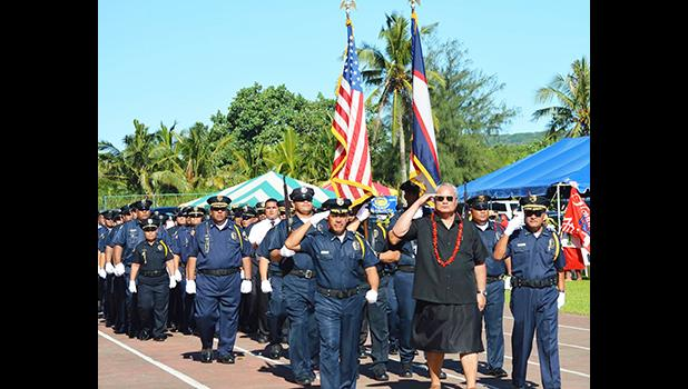Police Commissioner Le'i S. Thompson with DPS police officers during the 2016 flag day parade at the VA stadium in Tafuna.  [archive photo: AF]
