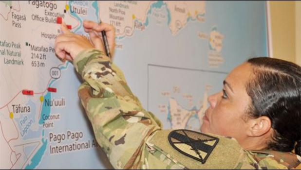 Chief Warrant Officer Sara Matos, assigned to the 303rd Maneuver Enhancement Brigade, 9th MSC, labels a map with critical locations during Ocean Sun EDRE in American Samoa, 14-18 Aug. (Photo by Capt. Liana Kim)